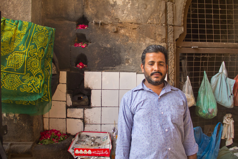The keeper of the Teen Darwaza lamp